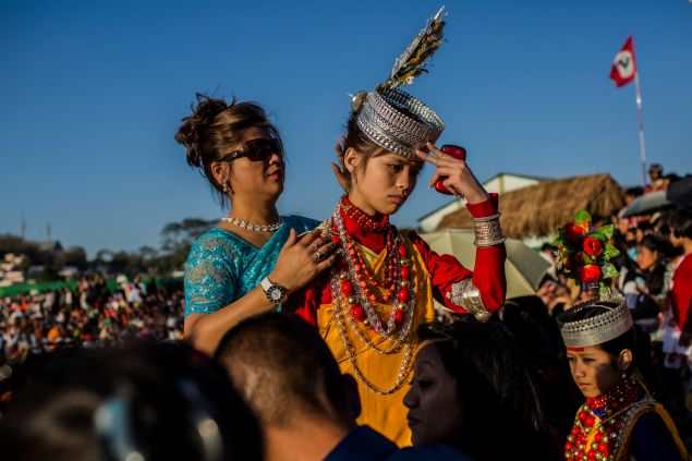 SHILLONG, INDIA - A tribal Khasi maiden in traditional costume, ahead of at traditional dance (Photo by Daniel Berehulak /Getty Images).