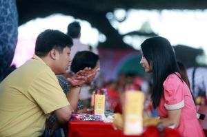 People chat during a matchmaking event for mostly mainland Chinese single men and Hong Kong single women in Dongguan, south China's Guangdong province on November 10, 2013. By 2020 sociologists in China expect an extra 35 million Chinese men to women, leaving millions of men little chance of finding a female partner. CHINA OUT AFP PHOTO