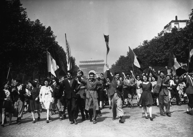 8th May 1945: Crowds on the Champs Elysees celebrate Victory in Europe at the end of World War II with a joyful procession. (Photo by Keystone/Getty Images)