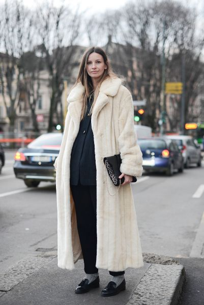 A prime example of a dramatic long coat (Photo: Vanni Bassetti/Getty Images).