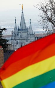 SLAT LAKE CITY, UT - JANUARY 28: The Salt Lake Temple of the Church of Jesus Christ of Latter-Day Saints sits in the background as several hundred people hold a pro-gay marriage rally outside the Utah State Capitol on January 28, 2014 in Salt Lake City, Utah. Several weeks ago a federal judge ruled unconstitutional a voter-approved ban on same-sex marriage in the state of Utah. The ruling has since been stayed and is working it's way through the legal system. (Photo by George Frey/Getty Images)