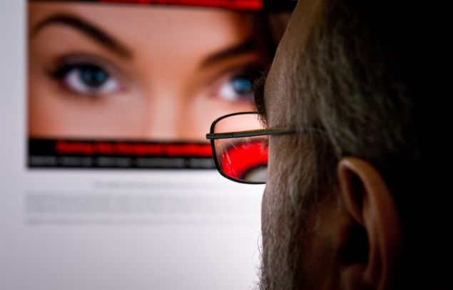 """A man looks at a dating site on his computer in Washington,DC on February 10, 2014. One 29-year-old woman says it helped her take revenge on her unfaithful husband. A 45-year-old married man says it has helped prevent the break-up of his family. For millions, adultery via the Internet has become the new normal. Since the launch of the Canada-based Ashley Madison website in 2002, which created a sensation with its seductive slogan """"Life is short, have an affair,"""" the numbers turning to online infidelity have soared. There are now dozens of similar websites offering the promise of extramarital relationships with domain names that are unabashedly direct, from www.datingforcheaters.com to www.heatedaffairs.com. For Noel Biderman, the founder of Ashley Madison, his site and others like it are merely facilitating a human desire that is as old as time. AFP PHOTO/EVA HAMBACH"""