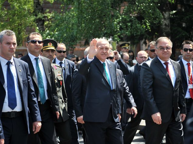 Turkish President, Recep Tayip Erdogan (2ndR) flanked by Chairman of Bosnia and Herzegovina's tripartite Presidency, Mladen Ivanic (R), waves at citizens gathered near the Presidency building during his one-day visit in Sarajevo, on May 20, 2015. AFP PHOTO / ELVIS BARUKCIC        (Photo credit should read ELVIS BARUKCIC/AFP/Getty Images)