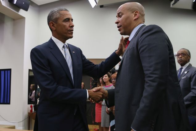 """WASHINGTON, DC - SEPTEMBER 18: (AFP OUT) U.S. President Barack Obama (L) greets Sen. Corey Booker (D-NJ) during a gathering of actors, hip-hip artists, justice activists, state and local elected officials and community leaders advocating for criminal justice reform in the Eisenhower Executive Office Building South Court Auditorium September 18, 2015 in Washington, DC. The leaders gathered for a screening of """"Fixing the System,"""" an upcoming special documentary about criminal justice reform. (Photo by Chip Somodevilla/Getty Images)"""