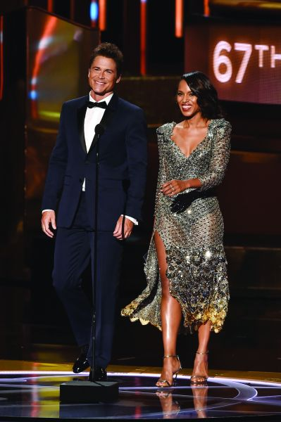 Rob Lowe in a navy Burberry suit with Kerry Washington (Photo: Kevin Winter/Getty Images).