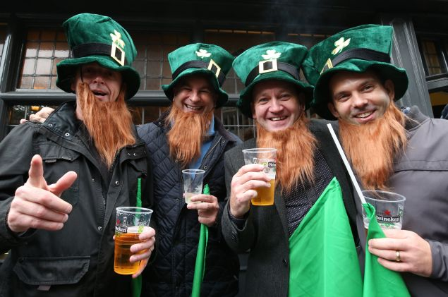 Rugby fans pose for a photograph outside a pub. (Photo by Matt Cardy/Getty Images)