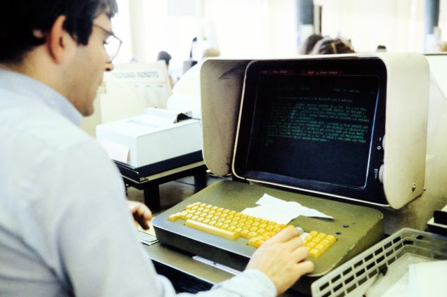 A journalist is seen working on a computer in the press room of French press agency Agence France-Presse in Paris September 1, 1981. (Photo credit should read -/AFP/Getty Images)