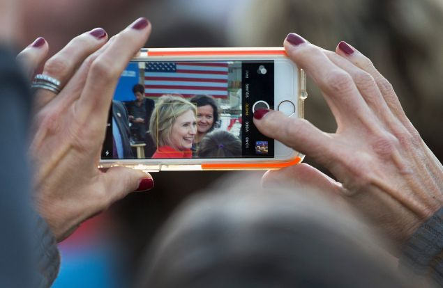 CORALVILLE, IA - NOVEMBER 03: A woman takes a picture with her phone as Democratic presidential candidate Hillary Clinton greets guests after speaking at a campaign event on November 3, 2015 in Coralville, Iowa. A recently released poll has Clinton expanding her lead over rival Bernie Sanders in their quest for the Democratic nomination for president. (Photo by Scott Olson/Getty Images)
