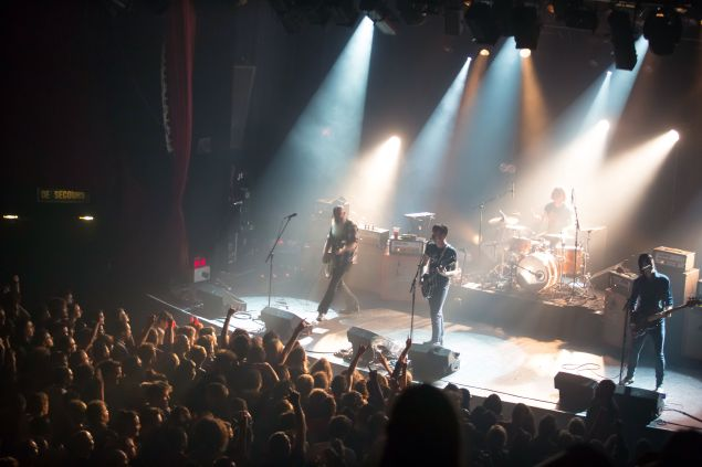 """American rock group Eagles of Death Metal perform on stage on November 13, 2015 at the Bataclan concert hall in Paris, few moments before four men armed with assault rifles and shouting """"Allahu akbar"""" (""""God is great!"""") stormed into the venue. Islamic State jihadists on November 14, 2015 claimed a series of coordinated attacks by gunmen and suicide bombers in Paris that killed at least 128 people in scenes of carnage at the Bataclan, restaurants and the national stadium. AFP PHOTO / ROCK&FOLK / MARION RUSZNIEWSKI (Photo credit should read Marion Ruszniewski/AFP/Getty Images)"""