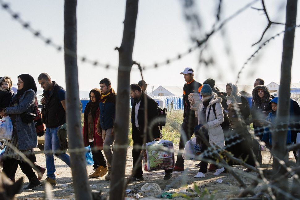 Migrants and refugees cross the Greek-Macedonian border near Gevgelija in November 2015.