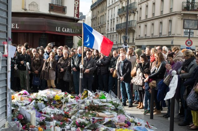 PARIS, FRANCE - NOVEMBER 16: People gather to observe a minute silence outside the Le Carillon restaurant in memory of the victims of the Paris terror attacks last Friday, on November 16, 2015 in Paris, France. Countries across Europe joined France, currently observing three days of national mourning, in a one minute-silence today in an expression of solidarity with the victims of the terrorist attacks, which left at least 129 people dead and hundreds more injured. (Photo by Thierry Orban/Getty Images)