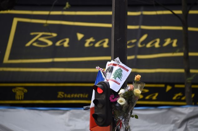Flowers are laid outside the Bataclan theatre in Paris, on November 18, 2015. (DOMINIQUE FAGET/AFP/Getty Images)