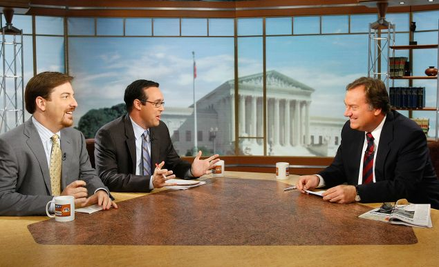 (L-R) Chuck Todd of NBC News and Chris Cillizza of WashingtonPost.com chat with the late Tim Russert during a taping of Meet the Press (Photo by Alex Wong/Getty Images for Meet the Press).