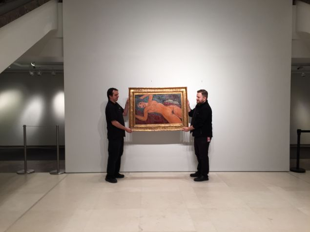 Art handlers at Christie's after Thursday evening's Impressionist and Modern Art evening sale whisking away Modigliani's recording-setting $170.4 million painting Nu Couché to its new owner Chinese billionaire Liu Yiqian. (Photo: Alanna Martinez)