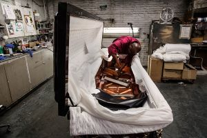 At work at the Brooklyn Casket Company. (Photo: Celeste Sloman for Observer)