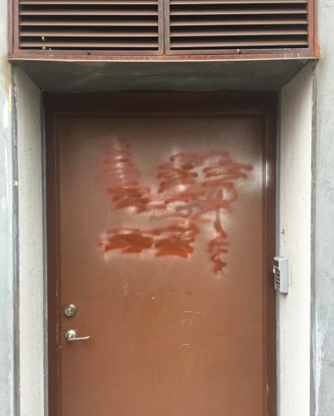 Artist Jim Thorell's studio door, which he painted over to conceal a swastika that was placed on it overnight.