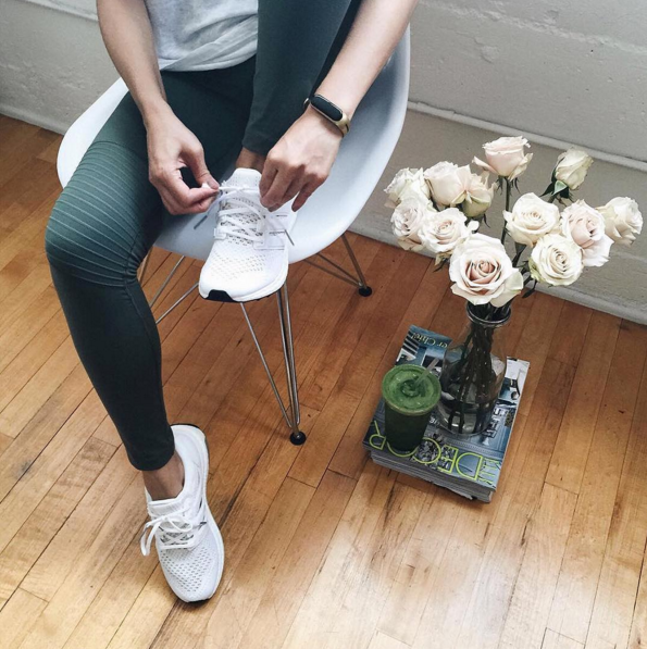 Blogger Aimee Santos, or @swellmayde, preps for a run while wearing her Mira Fit (Photo: Mira Instagram).
