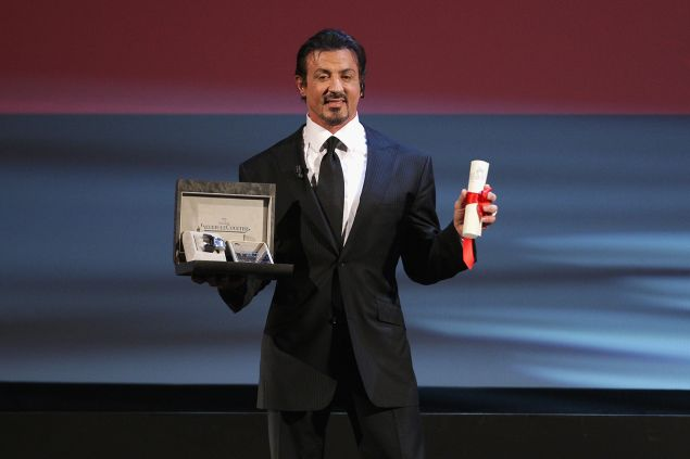 VENICE, ITALY - SEPTEMBER 12: Actor Sylvester Stallone poses with his Lifetime Achievement award while attending the Closing Ceremony at the Sala Grande during the 66th Venice Film Festival on September 12, 2009 in Venice, Italy.