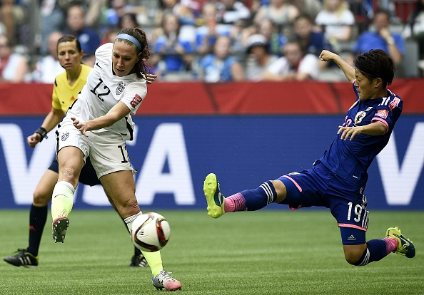 USA midfielder Lauren Holiday shoots in front of Japan's defender Saori Ariyoshi during the 2015 FIFA Women's World Cup final in Vancouver on July 5, 2015. (Photo: Frank Fife/AFP/Getty)