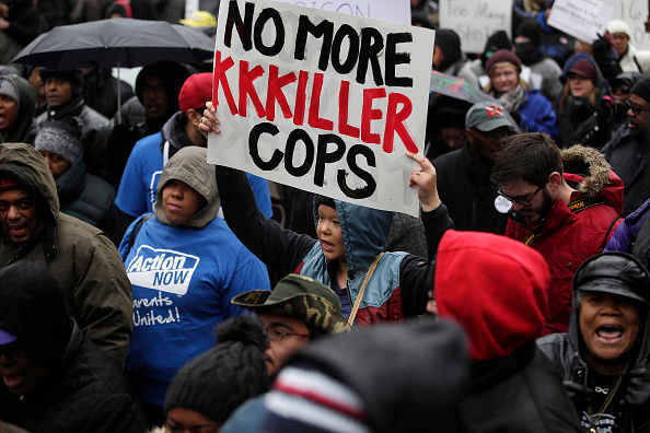 Demonstrators protest the shooting of Laquan McDonald, who was shot 16 times by Chicago police officer Jason Van Dyke. (Photo: Joshua Lott/Getty Images)