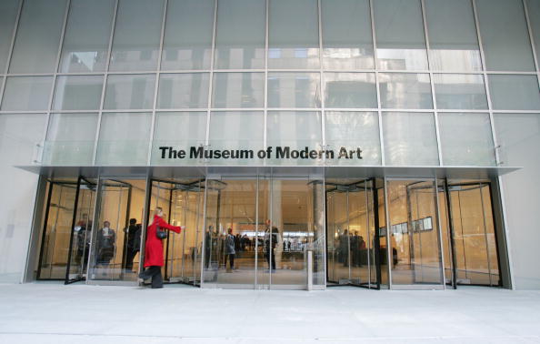 NEW YORK - NOVEMBER 15: A woman enters the newly remodeled Museum of Modern Art during a media preview of the building November 15, 2004 in New York City. The new museum, designed by Japanese architect Yoshio Taniguchi, nearly doubles the capacity of the former building and encompasses 630,000 square feet on six floors. The new building cost of $425 million and opens to the public November 20. (Photo by Mario Tama/Getty Images)