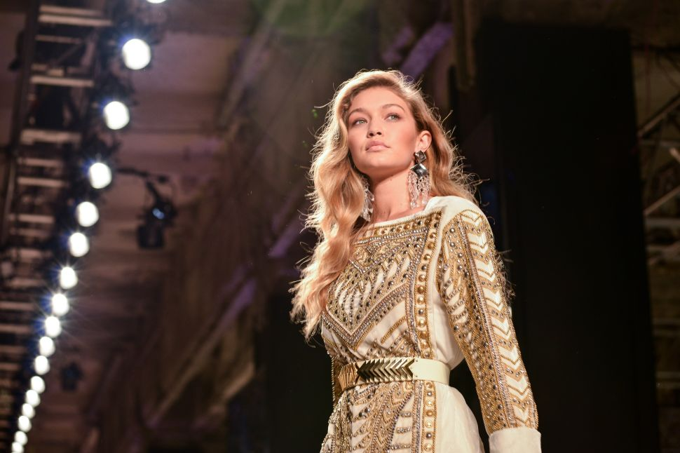 Gigi Hadid models in the H&M x Balmain runway show (Photo: Patrick McMullan).