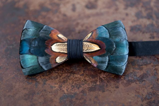 The Dawho bowtie pays homage to the South Carolina waterways by pairing navy feathers with pheasant (Photo: Brackish Bow Ties).
