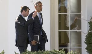 US President Barack Obama (R) speaks with Senior Advisor David Plouffe (JIM WATSON/AFP/Getty Images)