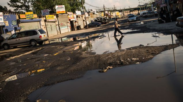 A flooded street in Willets Point. (Photo: Andrew Burton for Getty Images)