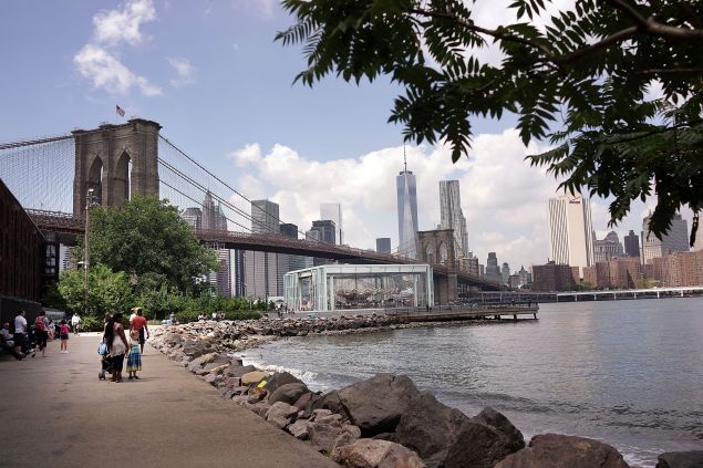 NEW YORK, NY - AUGUST 19: The Brooklyn Bridge is viewed from a park in in DUMBO, an acronym for Down Under the Manhattan Bridge Overpass, on August 19, 2014 in the Brooklyn borough of New York City. Brooklyn, once a quiet and affordable borough across from Manhattan, is now home to some of the most ambitious projects in New York City. The Atlantic Yards development project, the Brooklyn Bridge Park and the building of residential towers in downtown Brooklyn are just a few of the development projects quickly transforming the borough. In the first half of 2014 alone total investment property sales in Brooklyn rose 38 percent from the first half of 2013 to 884. (Photo by Spencer Platt/Getty Images)