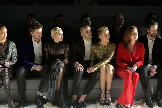 Jennifer Lopez, Patrick Schwarzenegger, Miley Cyrus, Romain Dauriac, Scarlett Johansson, Amy Adams, and actor Darren Le Gallo in the front row (Photo: Charley Gallay/Getty Images for Tom Ford)