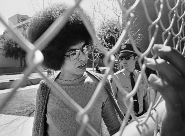 Picture released on April 1972 of US communist militant Angela Davis arriving at the court for her trial , in San Jose. Angela Davis was acquitted on charges of murder, kidnapping and conspiracy arising from the 07 August 1970 shooting in the same courthouse, in which a judge and three other people were killed. (Photo credit should read STRINGER/AFP/Getty Images)