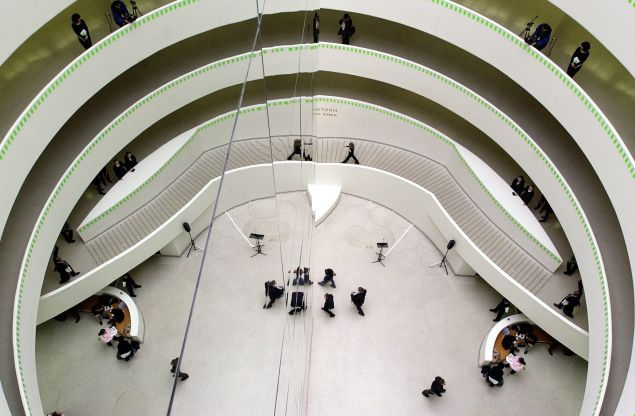The Guggenheim's Frank Lloyd Wright designed rotunda provides perfect acoustics for a choral concert. (STAN HONDA/AFP/Getty Images)