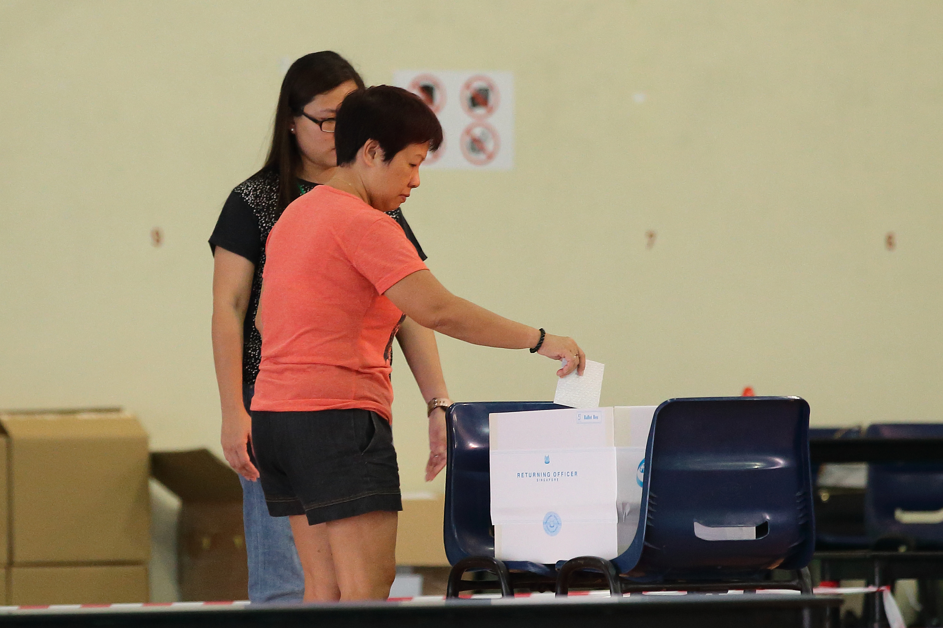 A resident casts a vote in Singapore's national election September 11 during the. (Photo: Suhaimi Abdullah/Getty Images)
