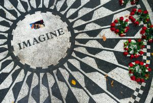 Crowds gathered in Central Park at the Strawberry Fields Memorial to remember the life of John Lennon on the 35th anniversary of his death