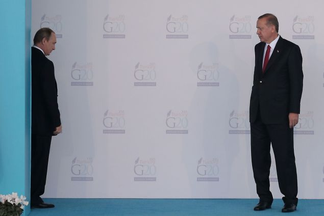 during the official welcome ceremony on day one of the G20 Turkey Leaders Summit on November 15, 2015 in Antalya, Turkey. World leaders will use the summit to discuss issues including, climate change, the global economy, the refugee crisis and terrorism. The two day summit takes place in the wake of the massive terrorist attack in Paris which killed more than 120 people.