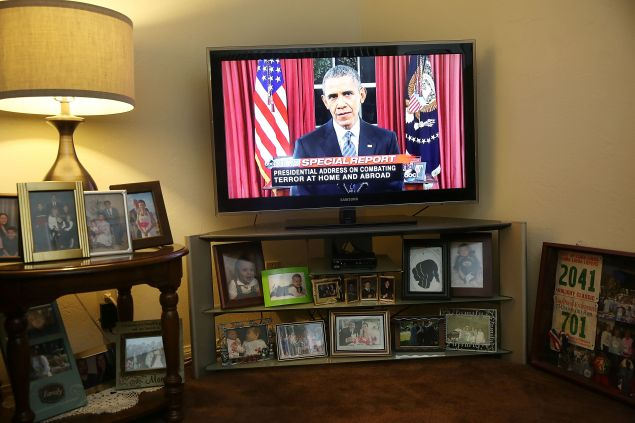 SAN BERNARDINO, CA - DECEMBER 06: U.S. President Barack Obama is seen on television in the home of Helen Medina, who had to hide as police engaged in a gun battle with terror suspects on the street in front, during his nationally-televised address from the White House about terrorism following the attack on the Inland Regional Center on December 6, 2015 in San Bernardino, California. Medina hid in her home as the police killed the terror suspects that attacked the Inland Regional Center in San Bernardino that left 14 people dead and another 21 injured on December 2. (Photo by Joe Raedle/Getty Images)