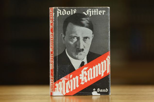 "BERLIN, GERMANY - DECEMBER 15: A 1941 edition of Adolf Hitler's ""Mein Kampf"" (""My Struggle"") stands at the library of the Deutsches Historisches Museum (German Historical Museum) on December 15, 2015 in Berlin, Germany. The state of Bavaria took possession of the copyright to the book after World War II, though the copyright is due to expire and the book will enter the public domain on January 1, 2016. Germany will continue to heavily restrict publication of the book in Germany though it will have little control over publications abroad. Hitler wrote the book that is both an autobiography and also presents his political vision while he was a prisoner in Germany in he 1920s. (Photo by Sean Gallup/Getty Images)"