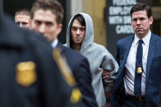 Martin Shkreli, CEO of Turing Pharmaceutical, is brought out of 26 Federal Plaza by law enforcement officials after being arrested for securities fraud last month (Photo: Andrew Burton for Getty Images)