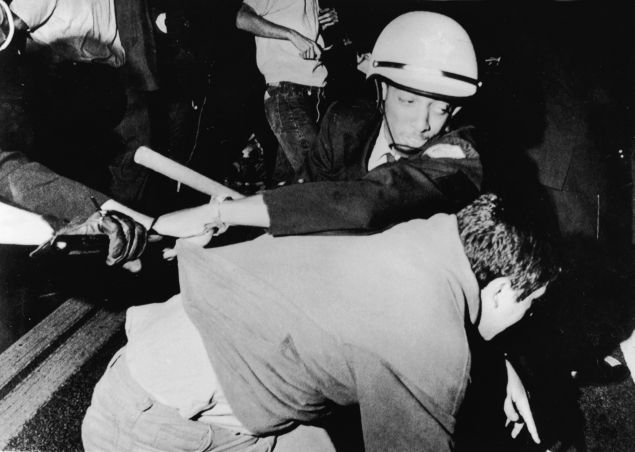 An officer from the Chicago Police Department struggles with an antiwar demonstrator outside Democratic headquarters at the Hilton Hotel on Michigan Avenue as demonstrators attempt to break through police lines to move the protest to the 1968 Democratic National Convention, being held five miles away at the International Amphitheatre, Chicago, Illinois, August 28, 1968. (Photo by APA/Getty Images)
