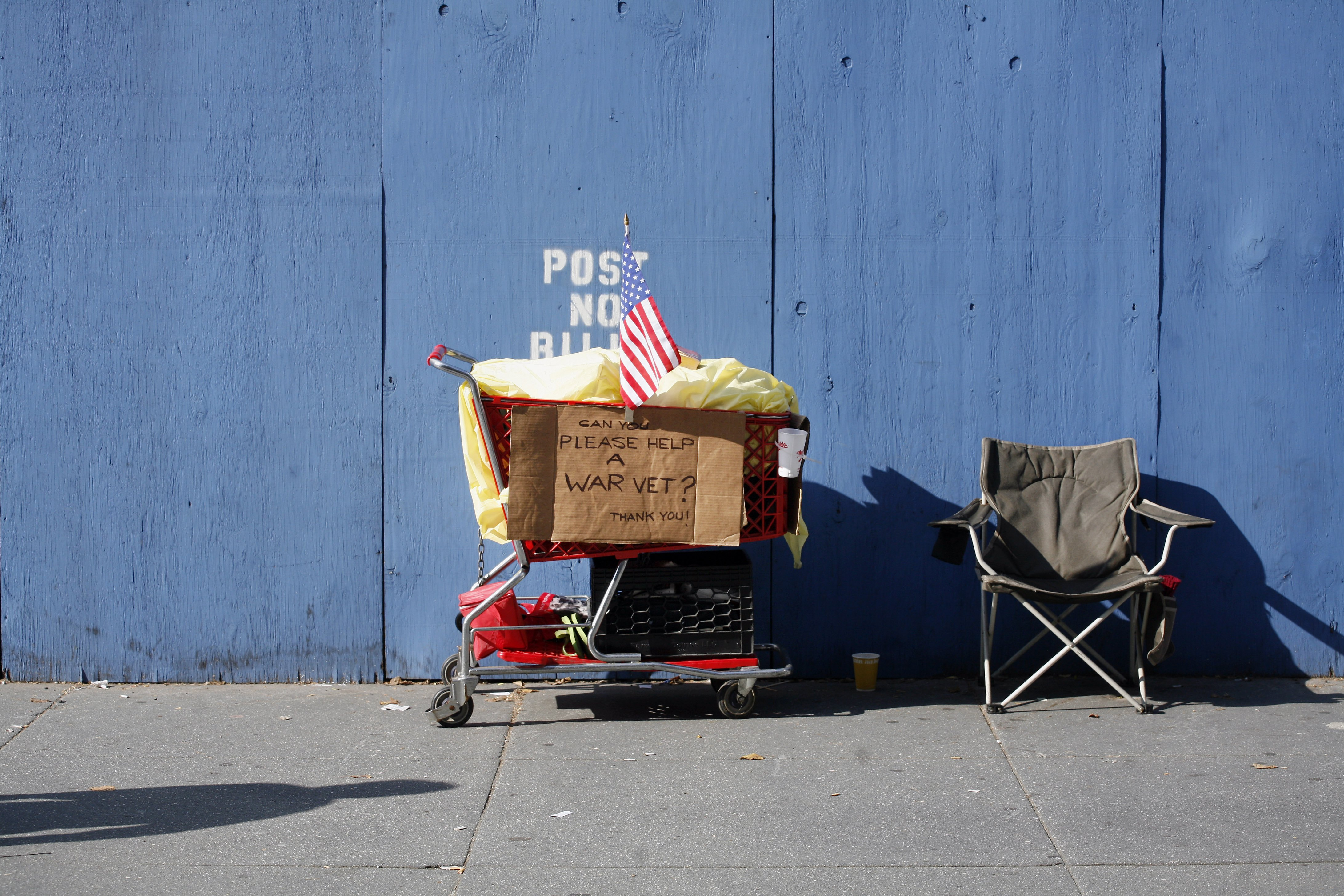 A homeless person's grocery cart and chair is shown along Fifth Avenue during the annual Veterans Day in 2006. (Photo by Michael Nagle/Getty Images)