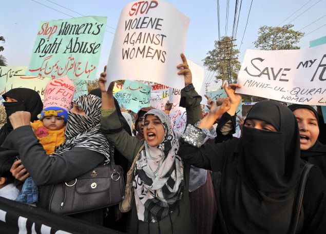 "Supporters of Tehrik-e-Minhaj ul Quran, an Islamic Organisation protest against ""honour killings"" of women in Lahore on November 21, 2008. Human rights lawyer Zia Awan said that more than 62,000 cases of women abused in Pakistan since the year 2000 and 159 women died in honour killings in the year to September 30. AFP PHOTO/Arif ALI (Photo credit should read Arif Ali/AFP/Getty Images)"