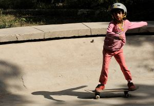 An Afghan girl rides a skateboard inside the bowl of an old concrete fountain during the celebration of International Go Skateboarding Day in Kabul on June 21, 2009. (Photo: SHAH MARAI/AFP/Getty Images)