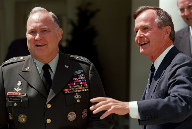 Gulf War commander, US four star general Norman Schwarzkopf (L), who commanded the international coalition which ousted Iraqi forces from Kuwait during Operation Desert Storm, and US President George Bush face media 23 April 1991 in the White House, Washington, D.C., before a private luncheon. (Photo credit should read J. DAVID AKE/AFP/Getty Images)