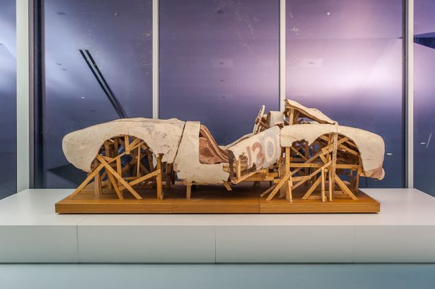 """Installation view of the exhibition """"Walkers: Hollywood Afterlives in Art and Artifact,"""" at Museum of the Moving Image, November 7, 2015–April 10, 2016. Organized by independent curator Robert M. Rubin. More information at http://movingimage.us/Walkers. Shown: Kristen Morgin, """"Wrecked Spyder,"""" 2010. Wood, wire, and unfired clay. 82 x 46 x 41 inches. Photo credit: Thanassi Karageorgiou / Museum of the Moving Image."""