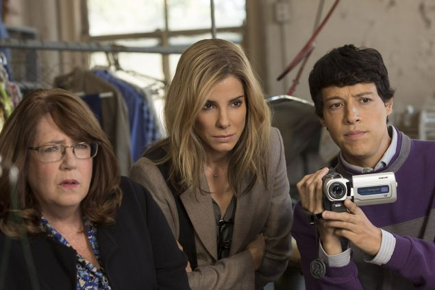 Sandra Bullock, at center, in Our Brand Is Crisis.
