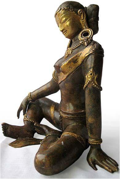 A bronze sculpture of the goddess Parvati.