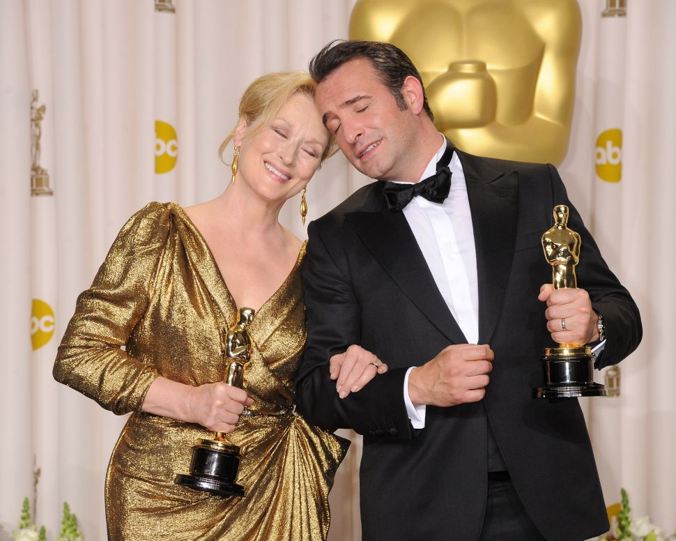 2012: Meryl Streep, Jean Dujardin pose in the press room at the 84th Annual Academy Awards with their awards for The Iron Lady and The Artist, respectively (Photo: Jeff Kravitz for FilmMagic)