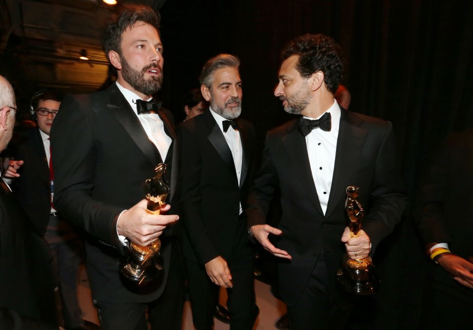 Ben Affleck, George Clooney, Grant Heslov, winners of the award for Best Motion Picture of the Year for Argo on February 24, 2013 (Photo: Christopher Polk for Getty Images).