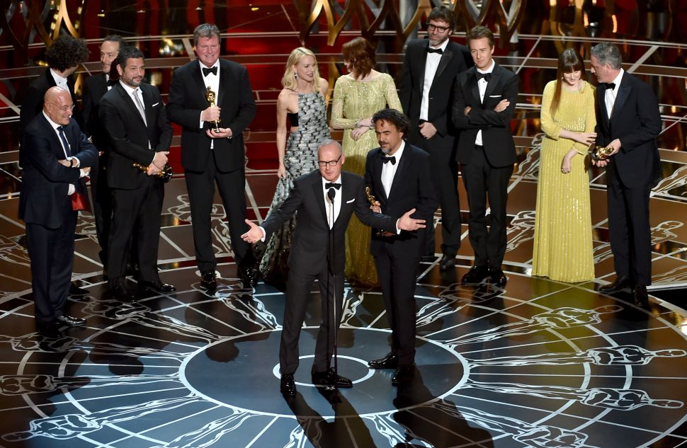 Michael Keaton, Alejandro Gonzalez Inarritu accept the Best Picture award for 'Birdman' onstage during the 87th Annual Academy Awards on February 22, 2015. (Photo by Kevin Winter for Getty Images).